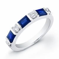 14 kt white gold band with 4 round diamonds 0.35 ct and 3 sapphire baguettes 0.95 ct.