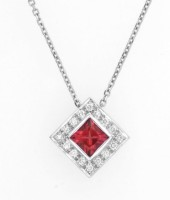 Diamonds and tourmaline in a diamond shaped pendant and white gold