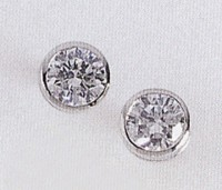 14 Karat whit gold bezel stud diamond earrings over 1 carat CT.